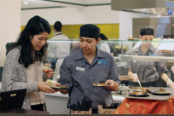 Chef and student meet at OceanView dining hall / Photo: Stephanie Kim, The Triton, UC San Diego