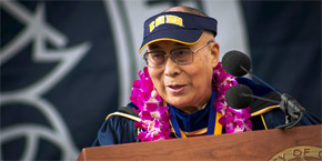 UC San Diego - Dalai Lama at podium wearing UCSD sun visor