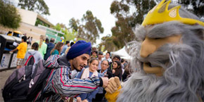 Triton mascot fist bumps a new student on Triton Day