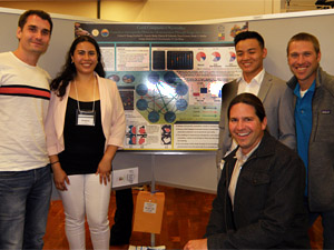 Students and faculty mentors post with poster, FMP Symposium 2016