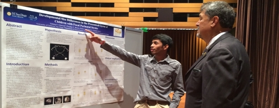 A student presenting a poster to VC Gonzalez