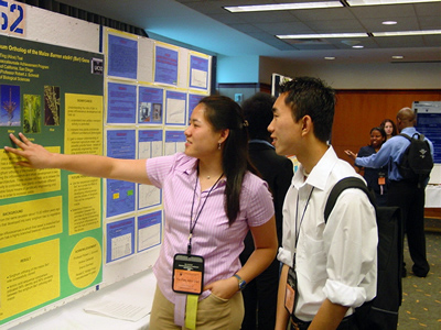 UCSD McNair Program students Alice Tsai and Trong Shawn Ta discuss research findings at an undergraduate research conference