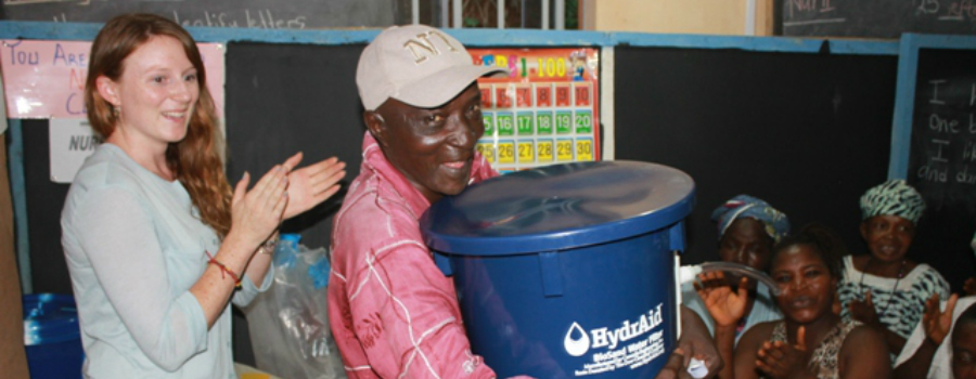 A water beneficiary in Sierra Leone due to a Strauss project.