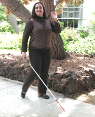 Student on campus with cane