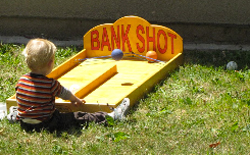 Boy playing Bank Shot game